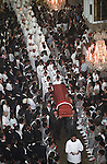 The casket is moved down the isle of the cathedral in Guatemala City, during the funeral of assasinated arch-bishop Juan Gerrardi. Bishop Gerrardi was assasinated just days after  his office issued a report on the country's 36-year civil war that was highly critical of the armed forces. The funeral of Guatemalan arch bishop monsignor Juan Gerardi in Guatemala City.