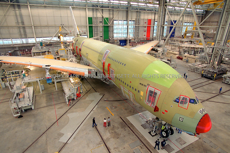 The first A380 super Jumbo is prepared for final assembly at Airbus's hanger. European aircraft maker Airbus launched production of its A380 ?superjumbo,? the biggest ever commercial airliner, stepping up its challenge to U.S. rival Boeing Co. which has staked its future on a new mid-sized jet.