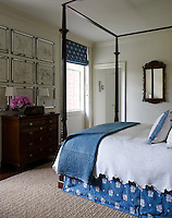 A guest bedroom is decorated in a blue and white colour scheme