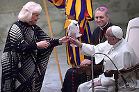Pope Francis Liana Orfei holds a parrot during a performance of the Golden Circus in the Paul VI Hall at the Vatican at the end of his weekly general audience Wednesday,  28, December.2016.