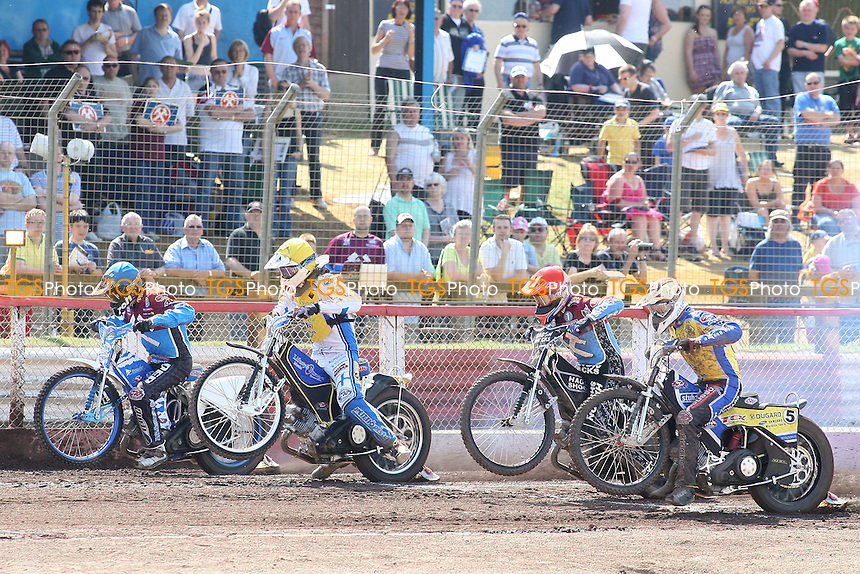 Heat 6: Richardson (red), Nieminen (blue), Kylmakorpi (white) and Lahti off the start - Lakeside Hammers vs Eastbourne Eagles - Elite League Speedway at Arena Essex Raceway - 22/04/11 - MANDATORY CREDIT: Gavin Ellis/TGSPHOTO - Self billing applies where appropriate - Tel: 0845 094 6026