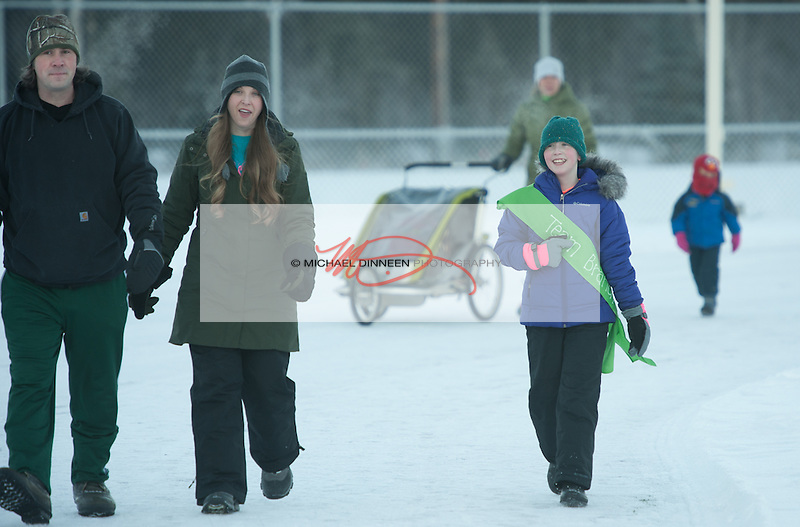 From left, Nick, Jen and daughter Maddy Brandle in the 5k run at Eagle River High School.  Photo for the Star by Michael Dinneen