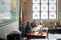 Madeline Hill '19 works with Nidia Lozano, Constituent Services Representative.<br /> Madeline Hill '19 is a summer intern as part of Occidental College's InternLA program at the Office of Los Angeles Mayor Eric Garcetti's Office of Public Engagement (MOPE).<br /> Career Services' InternLA is a paid summer internship program which helps Oxy students gain real-world work experience from actual businesses in Los Angeles and surrounding area.<br /> (Photo by Marc Campos, Occidental College Photographer)