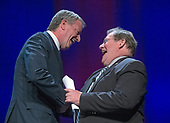 Mayor Bill de Blasio (Democrat of New York), left shakes hands with Mayor Mark Stodola (Democrat of Little Rock, Arkansas), right, after making remarks at the National League of Cities spring meeting at the Marriott Wardman Park Hotel in Washington, DC on Monday, March 12, 2018.<br /> Credit: Ron Sachs / CNP<br /> (RESTRICTION: NO New York or New Jersey Newspapers or newspapers within a 75 mile radius of New York City)