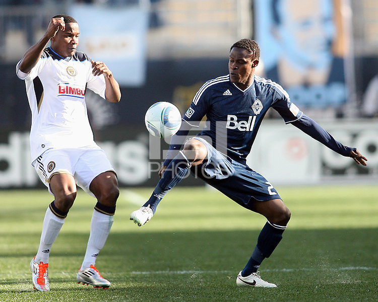 Danny Mwanga#10 of the Philadelphia Union and Gershon Koffie#28 of the Vancouver Whitecaps during an MLS match at PPL Park in Chester, PA. on March 26 2011. Union won 1-0.