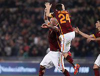 Calcio, Serie A: Roma vs Inter. Roma, stadio Olimpico, 19 marzo 2016.<br /> Roma&rsquo;s Radja Nainggolan, left, celebrates with teammates  Alessandro Florenzi, left, and Diego Perotti after scoring during the Italian Serie A football match between Roma and FC Inter at Rome's Olympic stadium, 19 March 2016. The game ended 1-1.<br /> UPDATE IMAGES PRESS/Isabella Bonotto