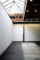 Industrial space with exposed beams and wooden flooring