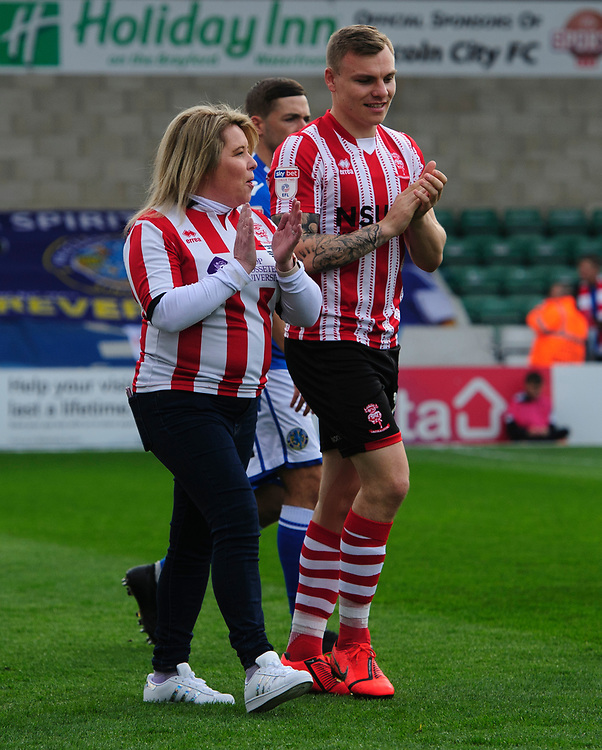 Lincoln City organised their first Mothers as Mascots day at Sincil Bank in celebration of Mother's Day on Sunday<br /> <br /> Photographer Chris Vaughan/CameraSport<br /> <br /> The EFL Sky Bet League Two - Lincoln City v Macclesfield Town - Saturday 30th March 2019 - Sincil Bank - Lincoln<br /> <br /> World Copyright © 2019 CameraSport. All rights reserved. 43 Linden Ave. Countesthorpe. Leicester. England. LE8 5PG - Tel: +44 (0) 116 277 4147 - admin@camerasport.com - www.camerasport.com