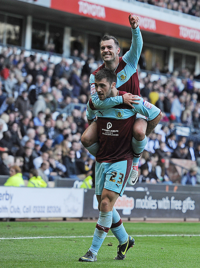 Burnley's Charlie Austin celebrates scoring his and his sides second goal in the last minutes of the match to secure a 2-1 victory with team-mate Ross Wallace..Football - npower Football League Championship - Derby County v Burnley - Saturday 22nd September 2012 - Pride Park - Derby..