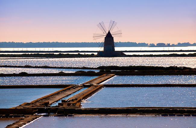 Ettore Infesera windmill on the sea salt making pans , Masala Sicily. travel stock photos