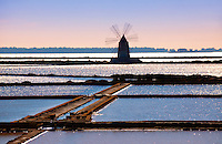 Ettore Infesera windmill on the sea salt making pans , Masala Sicily. travel stock photos