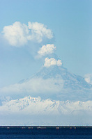 Mount Redoubt emits ash and steam into the atmosphere about 50 miles across Cook Inlet from Kenai, Alaska, during the volcano's eruptive period in 2009. Ash clouds from the volcano disrupted international and domestic air travel.