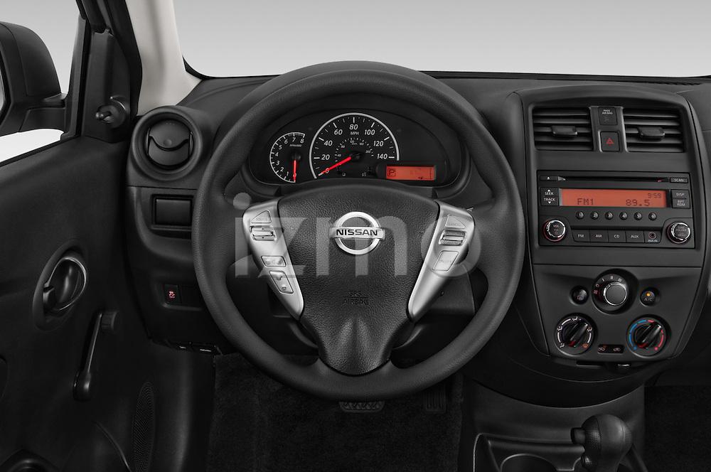 Car pictures of steering wheel view of a 2015 Nissan Versa 1.6 Sv Cvt 4 Door Sedan