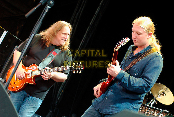 DEREK TRUCKS & WARREN HAYNES of The Allman Brothers Band.Live in concert on their 2006 Tour at the Post-Gazette Pavilion, Pittsburgh, Pennsylvania, USA,.16 August 2006..half length band music gig on stage guitars.Ref: ADM/JN.www.capitalpictures.com.sales@capitalpictures.com.©Jason L Nelson/AdMedia/Capital Pictures.