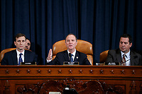 United States Representative Adam Schiff (Democrat of California), Chairman, US House Permanent Select Committee on Intelligence (C), with Democratic legal counsel Daniel Goldman (L) and United States Representative Devin Nunes (Republican of California), Ranking Member, US House Permanent Select Committee on Intelligence (R), delivers his  closing remarks during the House Permanent Select Committee on Intelligence public hearing on the impeachment inquiry into US President Donald J. Trump, on Capitol Hill in Washington, DC, USA, 19 November 2019. The impeachment inquiry is being led by three congressional committees and was launched following a whistleblower's complaint that alleges US President Donald J. Trump requested help from the President of Ukraine to investigate a political rival, Joe Biden and his son Hunter Biden.<br /> Credit: Shawn Thew / Pool via CNP/AdMedia
