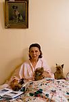 Her Serene Highness Elisabeth de Croy, in bed with her dogs. France 1980s.