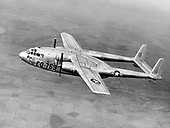 "The C-119, developed from the World War 2 Fairchild C-82, was designed to carry cargo, personnel, litter patients, and mechanized equipment, and to drop cargo and troops by parachute. The first C-119 made its initial flight in November, 1947 and by the time production ceased in 1955, more than 1,100 C-119s had been built. The United States Air Force (USAF) used the airplane extensively during the Korean War and many were supplied to the United States Navy and Marine Corps and to the Air Forces of Canada, Belgium, Italy, and India. In South Vietnam, the airplane once again entered combat, this time in a ground support role as AC-119 ""gunships"" mounting side-firing weapons capable of firing up to 6,000 rounds per minute per gun. .Credit: U.S. Air Force via CNP"