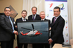 """Minister Dempsey signs New Search and Rescue Helicopter Contract on Behalf of the Irish Coast Guard..Pictured Presenting a Picture of the new Aircraft to the Minister Noel Dempsey, (L) Mark Kelly, Managing Director, CHC Ireland, Mark McComiskey, Chairman CHC, Tilmann Gabriel, President CHC Europe, Chris Reynolds, Director Irish Coast Guard and Minister Noel Dempsey..Picture Fran Caffrey/www.newsfile.ie..Minister Dempsey signs New Search and Rescue Helicopter Contract..""""These Helicopters will improve the capacity, range, speed and capability of Ireland's search and rescue service,"""" states Dempsey...New type Sikorsky S92A Helicopter on display at ceremony...The Minister for Transport Mr Noel Dempsey, T. D. today signed the contract awarding the provision of Helicopter SAR services to CHC Ireland. Transition to the modern helicopters will start in July 2012, and will run for ten years; with an option to extend for a further three years on a year by year basis. It represents a marked improvement in the capacity, range, speed and capability of Ireland's search and rescue service...The contract represents a continuation of the existing level of service with the principal change being the replacement of the Sikorsky S61N aircraft, with the 'new generation' Sikorsky S92A aircraft. These aircraft will operate out of Waterford, Shannon, Sligo and Dublin...Minister Dempsey said: """"I am delighted to sign this contract which will provide for the delivery of a top-class SAR service operating out of Bases in Waterford, Shannon, Sligo and Dublin up to 2022. There are over 130 jobs in this service and we anticipate that over 20 new posts will be created. CHC Ireland has an excellent record in delivering SAR services to our Coast Guard. The contract provides for helicopters that will fly to the scene of the mission faster. They find the vessels or persons in the water more efficiently using better search, surveillance and tracking tools. This will provide better medical facilities onb"""