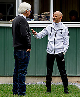 ELMONT, NY - JUNE 07: Trainer Bob Baffert and jockey Mike Smith talk at the barn after Triple Crown hopeful Justify exercised as horses prepare Thursday for the 150th running of the Belmont Stakes at Belmont Park on June 7, 2018 in Elmont, New York. (Photo by Scott Serio/Eclipse Sportswire/Getty Images)