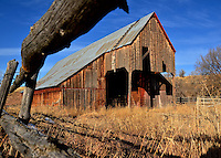 An old barn shows the evidence of time and weather.  Oakley, Utah.