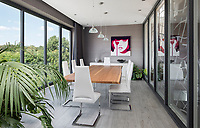 BNPS.co.uk (01202 558833)<br /> Pic: HamptonsInternational/BNPS<br /> <br /> Dining rooms with views...<br /> <br /> A futuristic 'Hollywood Hills' home which is nestled in the English countryside has emerged on the market for almost £5million.<br /> <br /> Harwin, in Bourne End, Bucks, would not look out of place on the big screen with its striking modern design.<br /> <br /> The five bedroom property which offers stunning views of the Thames Valley has its own cinema, gym and swimming pool.<br /> <br /> It is being sold with estate agent Hamptons International with a guide price of £4.75million.