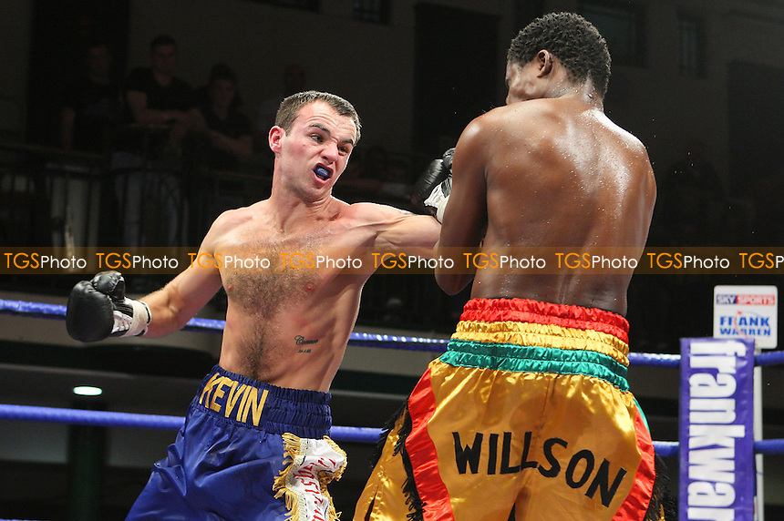 Kevin Mitchell (Dagenham, blue shorts) defeats Lanquaye Wilson (gold shorts) in a Super-Featherweight boxing contest at York Hall, Bethnal Green, promoted by Frank Warren / Sports Network - 22/05/09 - MANDATORY CREDIT: Gavin Ellis/TGSPHOTO - Self billing applies where appropriate - 0845 094 6026 - contact@tgsphoto.co.uk - NO UNPAID USE.