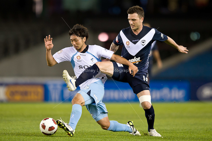 MELBOURNE, AUSTRALIA - OCTOBER 16, 2010: Billy Celeski of Melbourne Victory and Hirofumi Moriyasu of Sydney FC fight for the ball in Round 10 of the 2010 A-League between the Melbourne Victory and Sydney FC at Etihad Stadium on Octboer 16, 2010 in Melbourne, Australia. (Photo by Sydney Low / Asterisk Images)