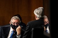 """United States Senator Dick Durbin (Democrat of Illinois) talks with US Senator Sheldon Whitehouse (Democrat of Rhode Island) during a Senate Judiciary Committee Hearing """"to examine COVID-19 fraud, focusing on law enforcement's response to those exploiting the pandemic"""" on Capitol Hill in Washington, DC on June 9, 2020.<br /> Credit: Erin Schaff / Pool via CNP/AdMedia"""