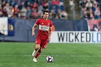 FOXBOROUGH, MA - AUGUST 25: Brandt Bronico #13 of Chicago Fire dribbles at midfield during a game between Chicago Fire and New England Revolution at Gillette Stadium on August 24, 2019 in Foxborough, Massachusetts.