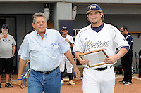 16 May 2010:  FIU's Tim Jobe (26) and family make their way onto the field prior to the game as FIU honored its seniors.  The FIU Golden Panthers defeated the University of South Alabama Jaguars, 5-0, at University Park Stadium in Miami, Florida.