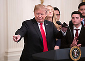 """United States President Donald J. Trump makes remarks prior to his signing an executive order that will require colleges that receive federal research grant money to certify that they """"promote free inquiry"""" in the East Room of the White House in Washington, DC on Thursday, March 21, 2019.<br /> Credit: Ron Sachs / CNP"""