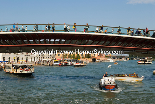 Venice Italy 2009. Tourists walk over new bridge over the Grand Canal from Piazza Roma towards the railway station.