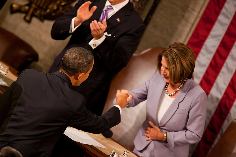 WASHINGTON, DC - Jan 27: President Barack Obama greets House Speaker Nancy Pelosi, D-Calif., before Obama delivered his first State of the Union address to a joint session of the U.S. Congress. (Photo by Ryan Kelly/Congressional Quarterly)