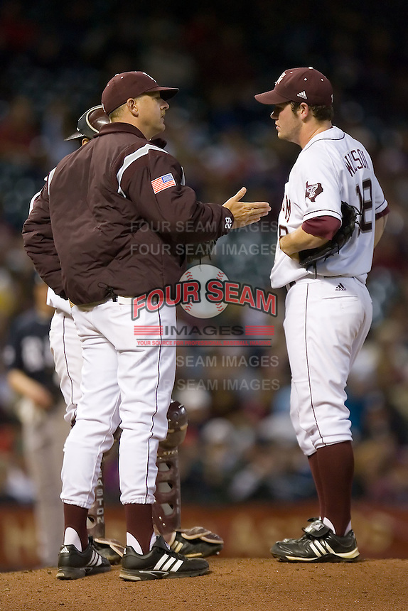 Texas A&M Aggies head coach Rob Childress #29 chats with his pitcher Alex Wilson #18 at the 2009 Houston College Classic at Minute Maid Park February 28, 2009 in Houston, TX.  The Rice Owls defeated the Aggies 2-0. (Photo by Brian Westerholt / Four Seam Images)