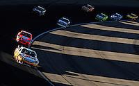 Mar 2, 2008; Las Vegas, NV, USA; NASCAR Sprint Cup Series driver Greg Biffle (16) leads Jeff Burton during the UAW Dodge 400 at Las Vegas Motor Speedway. Mandatory Credit: Mark J. Rebilas-US PRESSWIRE