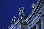 Statues against a night sky on top of the Vatican, Rome, Italy