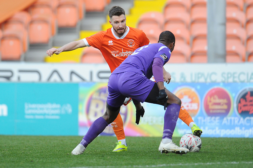 Blackpool's James Husband under pressure from Maidstone United's Gavin Hoyte<br /> <br /> Photographer Kevin Barnes/CameraSport<br /> <br /> Emirates FA Cup Second Round - Blackpool v Maidstone United - Sunday 1st December 2019 - Bloomfield Road - Blackpool<br />  <br /> World Copyright © 2019 CameraSport. All rights reserved. 43 Linden Ave. Countesthorpe. Leicester. England. LE8 5PG - Tel: +44 (0) 116 277 4147 - admin@camerasport.com - www.camerasport.com