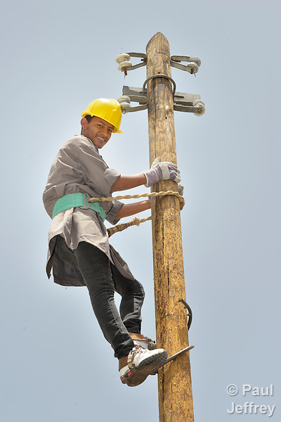 Student Emad Abu Holli climbs a utility pole during a class on electrical wiring at the Vocational Training Center in Khan Yunis, Gaza. The center is sponsored by the Department of Service for Palestinian Refugees of the Near East Council of Churches, and funded in part by the Pontifical Mission for Palestine. DSPR is a member of the ACT Alliance.
