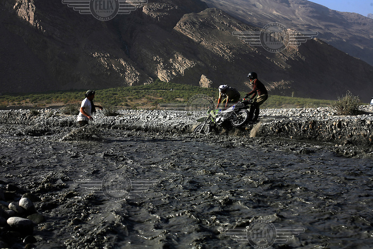 day 6, every one pitches in to help salvage the bike out of the river. What do war correspondences do on the holidays. 4 Kabul based journalists were the first westerners to ride motorcycles into the Wakhan corridor.the 12 day trip was full with dramas, breakdowns, arrests, crashes, yak riding and many miles. over 1200 kms they travelled and reached their desired destination of surhad e brogil deep in the wakhan corridor. location of the great game and once named the roof of the world.