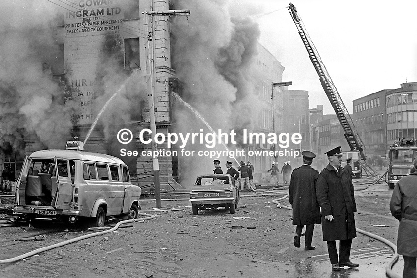 Firemen tackle blaze following Provisional IRA 500 lb bomb attack on the RUC police station, Musgrave Street, Belfast, N Ireland. Adjacent buildings seemed to have suffered more damage than the actual police station. It was claimed the bomb attack was in retaliation for the death of IRA member Hugh Coney who was shot dead by a sentry during an escape attempt at the Maze Prison. Twenty nine other prisoners were captured within a few yards of the prison, and the remaining three were back in custody within 24 hours. 1974110604c.<br /> <br /> Copyright Image from Victor Patterson,<br /> 54 Dorchester Park, Belfast, UK, BT9 6RJ<br /> <br /> t1: +44 28 90661296<br /> t2: +44 28 90022446<br /> m: +44 7802 353836<br /> <br /> e1: victorpatterson@me.com<br /> e2: victorpatterson@gmail.com<br /> <br /> For my Terms and Conditions of Use go to<br /> www.victorpatterson.com