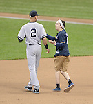 Derek Jeter (Yankees),<br /> MAY 9, 2014 - MLB :<br /> A Brewers fan talks to Derek Jeter of the New York Yankees as he invades the field during the Major League Baseball game between the New York Yankees and the Milwaukee Brewers at Miller Park in Milwaukee, Wisconsin, United States. (Photo by AFLO)