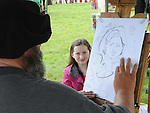 Kaetlyn Shanley gets her portrait drawn at the Ladywell Fete at Slane Castle. Photo: Colin Bell/pressphotos.ie