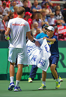 Switserland, Genève, September 20, 2015, Tennis,   Davis Cup, Switserland-Netherlands, Thiemo de Bakker (NED) receives a zowel from a ballboy<br /> Photo: Tennisimages/Henk Koster