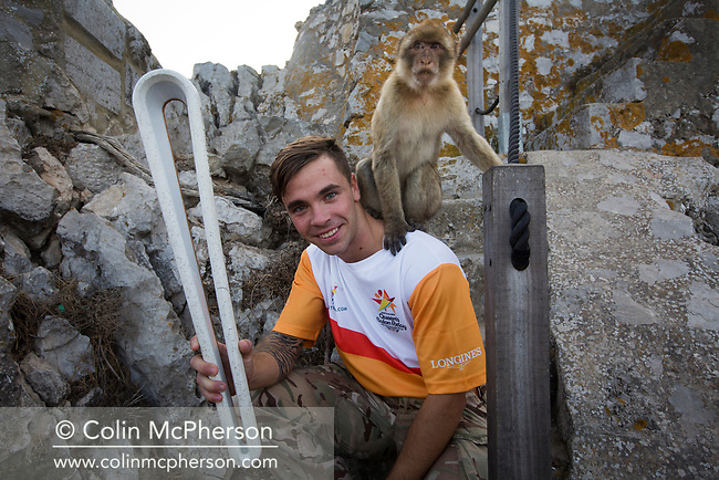 The Queen's Baton Relay spent its last full day in Gibraltar where it took part in a variety of events. This Queen's Baton Relay will engage with all 70 nations and territories of the Commonwealth, over 388 days and cover 230,000km. It will be the longest Relay in Commonwealth Games history, finishing at the Opening Ceremony on the Gold Coast on 4th April 2018. Photograph shows members of HM Forces with the Baton and a macaque on the Rock during a section of Relay.