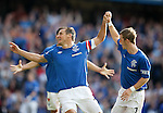 Captain Lee McCulloch celebrates after scoring the fifth goal for Rangers