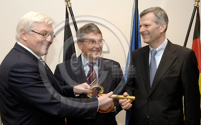 Brussels-Belgium - 20 March 2006---Inauguration / handover of the new building of Germany's Permanent Representation to the EU and the German Embassy to the Kingdom of Belgium by the Federal Minister for Foreign Affairs of Germany, Dr. Frank-Walter STEINMEIER (le); here, Ambassador Dr. Wilhelm SCHOENFELDER (Schönfelder) (ce), Permanent Representative of Germany to the EU, and Dr. Christoph JESSEN (ri), Ambassador to the Kindom of Belgium, receiving/holding a symbolic key---Photo: Horst Wagner/eup-images