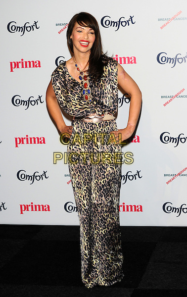 Katie Piper.Prima High Street Fashion Awards, Battersea Evolutions, Battersea Park, London, England..September 8th, 2011.full length dress hand on hip black blue beige leopard print red necklace .CAP/CJ.©Chris Joseph/Capital Pictures.