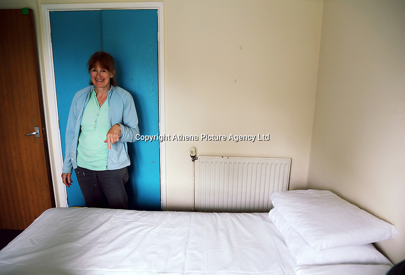 Pictured L-R: Christine Hughes helps prepare a double bed for the family of refugees in a house in Narberth, Wales, UK. Tuesday 11 July 2017<br /> Re: A family of Syrian refugees will be given accommodation in Narberth, Pembrokeshire, Wales, UK.