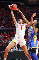 College Park, MD - March 25, 2019: UCLA Bruins guard Kennedy Burke (22) blocks Maryland Terrapins forward Shakira Austin (1) shot during game between UCLA and Maryland at  Xfinity Center in College Park, MD.  (Photo by Elliott Brown/Media Images International)