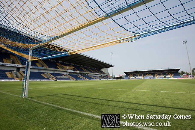 Mansfield Town Football Club Open Day, 14/07/2013. Field Mill stadium, League Two. Mansfield Town's Field Mill stadium with the Ian Greaves Stand (left) standing ready for the new season during an open day held for the club's supporters. Mansfield Town achieved promotion back to England's Football League by winning the Conference National in season 2012-13. Field Mill was the oldest ground in the Football League, hosting football since 1861 although some reports date it back as far as 1850, with Mansfield Town having played there since 1919. Photo by Colin McPherson.
